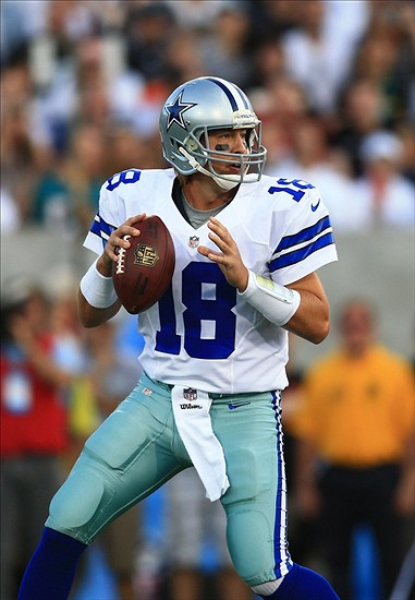 Aug 4, 2013; Canton, OH, USA; Dallas Cowboys quarterback Kyle Orton (18) drops back to pass in the first quarter of the 2013 Pro Football Hall of Fame game against the Miami Dolphins at Fawcett Stadium. Mandatory Credit: Andrew Weber-USA TODAY Sports