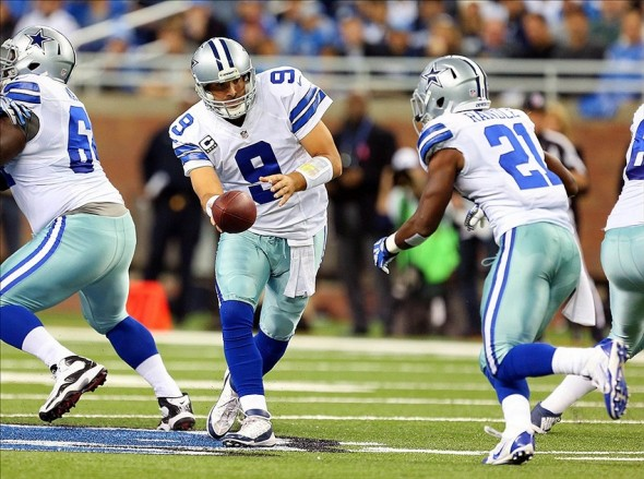 Oct 27, 2013; Detroit, MI, USA; Dallas Cowboys quarterback Tony Romo (9) attempts to hand the ball off to Dallas Cowboys running back Joseph Randle (21) during 1st quarter of a game at Ford Field. Mandatory Credit: Mike Carter-USA TODAY Sports