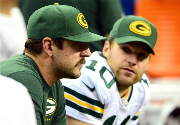 Nov 28, 2013; Detroit, MI, USA; Green Bay Packers quarterback Aaron Rodgers (left) sits on the bench next to quarterback Matt Flynn (10) during the fourth quarter of a NFL football game against the Detroit Lions on Thanksgiving at Ford Field. Mandatory Credit: Andrew Weber-USA TODAY Sports