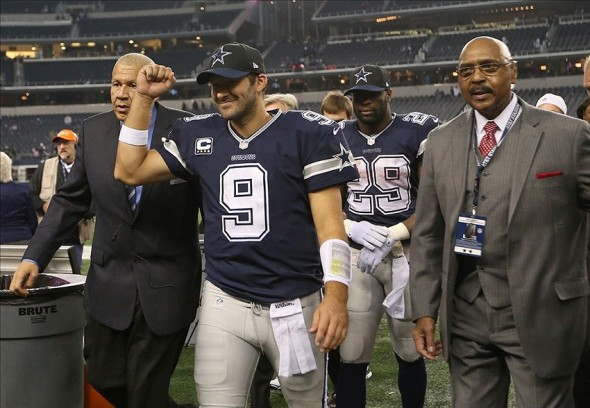 Nov 28, 2013; Arlington, TX, USA; Dallas Cowboys quarterback Tony Romo (9) pumps his fist as he walks off the field against the Oakland Raiders during a NFL football game on Thanksgiving at AT