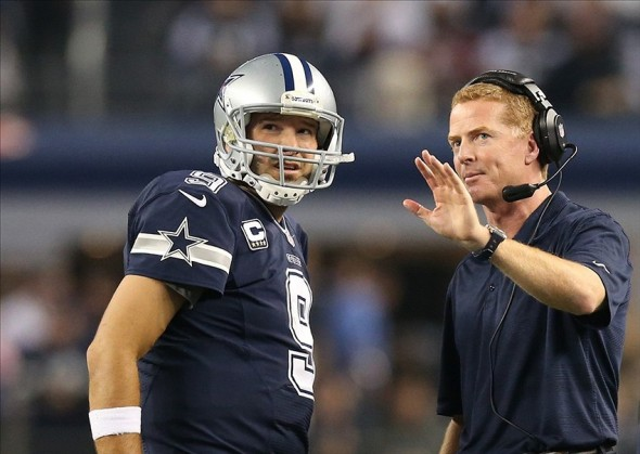 Nov 28, 2013; Arlington, TX, USA; Dallas Cowboys quarterback Tony Romo (9) talks with head coach Jason Garrett during a timeout from the game against the Oakland Raiders during a NFL football game on Thanksgiving at AT