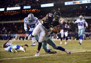 Dec 9, 2013; Chicago, IL, USA; Chicago Bears running back Matt Forte (22) rushes into the end zone for a touchdown during the third quarter against the Dallas Cowboys at Soldier Field. Mandatory Credit: Andrew Weber-USA TODAY Sports