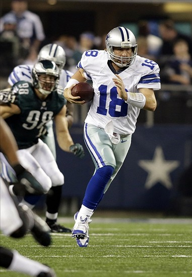 Dec 29, 2013; Arlington, TX, USA; Dallas Cowboys quarterback Kyle Orton (18) scrambles for a first down against the Philadelphia Eagles in the second quarter at AT