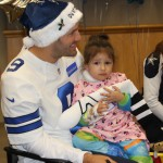 Tony Romo visits with a patient while handing out gifts and signing autographs at Children's Medical in Dallas — Jordan Ross