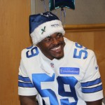 Linebacker Ernie Sims can't contain his joy visiting the patients at Children's Medical in Dallas — Jordan Ross