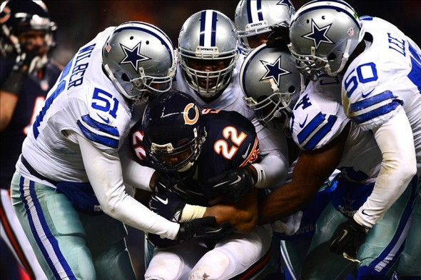 Dec 9, 2013; Chicago, IL, USA; Chicago Bears running back Matt Forte (22) is tackled by the Dallas Cowboys defense during the third quarter at Soldier Field. Mandatory Credit: Andrew Weber-USA TODAY Sports