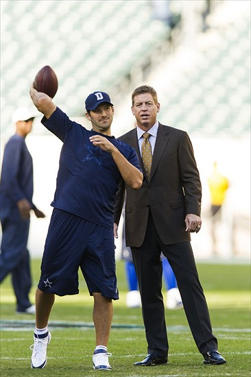 Nov 11, 2012; Philadelphia, PA, USA; Troy Aikman (R) talks with Dallas Cowboys quarterback Tony Romo (9) during warmups prior to playing the Philadelphia Eagles at Lincoln Financial Field. Mandatory Credit: Howard Smith-USA TODAY Sports