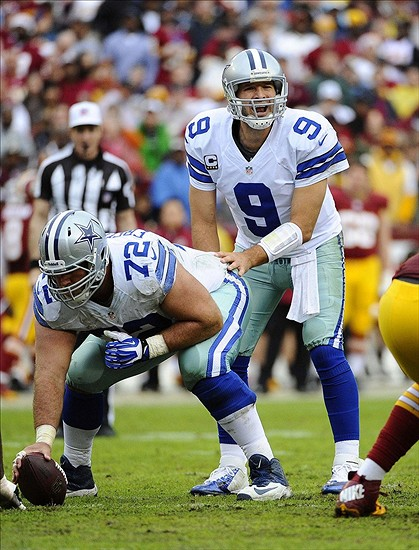 Dec 22, 2013; Landover, MD, USA; Dallas Cowboys quarterback Tony Romo (9) shouts instructions against the Washington Redskins during the first half at FedEx Field. Mandatory Credit: Brad Mills-USA TODAY Sports