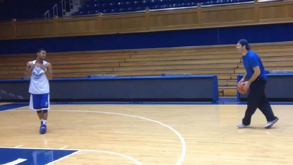 Dallas Cowboys quarterback Tony Romo shooting a game of hoops at Cameron Indoor Stadium.