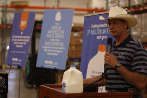 Former Dallas Cowboys TE Jay Novacek speaks at The Great American Milk Drive kickoff event at the North Texas Food Bank