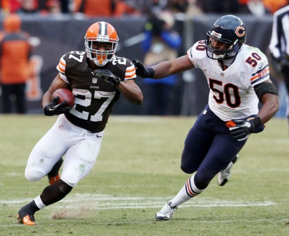 Dec 15, 2013; Cleveland, OH, USA; Cleveland Browns running back Edwin Baker (27) runs past Chicago Bears outside linebacker James Anderson (50) during the third quarter at FirstEnergy Stadium. Mandatory Credit: Ron Schwane-USA TODAY Sports