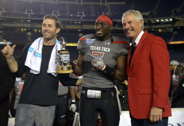 Dec 30, 2013; San Diego, CA, USA; Texas Tech Red Raiders coach Kliff Kingsbury (left) and linebacker Will Smith (7) pose with San Diego County Bowl association president Bill Geppert after the 2013 Holiday Bowl against the Arizona State Sun Devils at Qualcomm Stadium. Texas Tech defeated Arizona State 37-23. Mandatory Credit: Kirby Lee-USA TODAY Sports