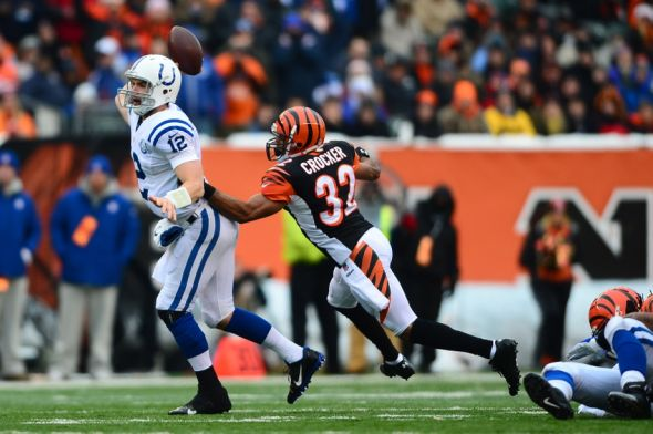 Dec 8, 2013; Cincinnati, OH, USA; Indianapolis Colts quarterback Andrew Luck (12) throws a pass while being pressed by Cincinnati Bengals defensive back Chris Crocker (32) during the second quarter at Paul Brown Stadium. Mandatory Credit: Andrew Weber-USA TODAY Sports