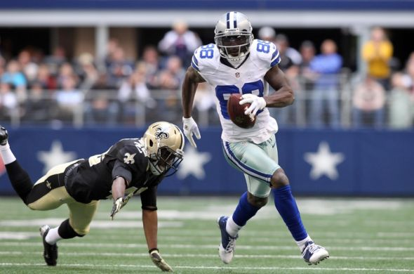 Dec 23, 2012; Arlington, TX, USA; Dallas Cowboys wide receiver Dez Bryant (88) runs for a touchdown after making a catch pass during the game against New Orleans Saints safety Isa Abdul-Quddus (42) at Cowboys Stadium. Mandatory Credit: Tim Heitman-USA TODAY Sports