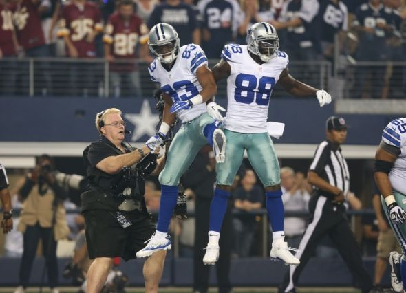 Oct 13, 2013; Arlington, TX, USA; Dallas Cowboys receiver Terrance Williams (83) celebrates a third quarter touchdown in the third quarter with Dez Bryant (88) against Washington Redskins cornerback David Amerson (39) at AT&T Stadium. Mandatory Credit: Matthew Emmons-USA TODAY Sports