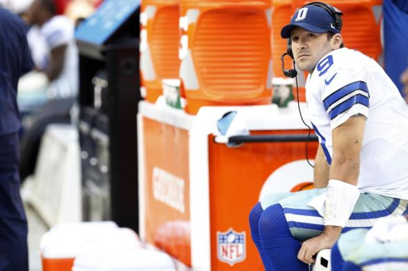 Dec 22, 2013; Landover, MD, USA; Dallas Cowboys quarterback Tony Romo (9) watches from the bench against the Washington Redskins in the fourth quarter at FedEx Field. The Cowboys won 24-23. Mandatory Credit: Geoff Burke-USA TODAY Sports