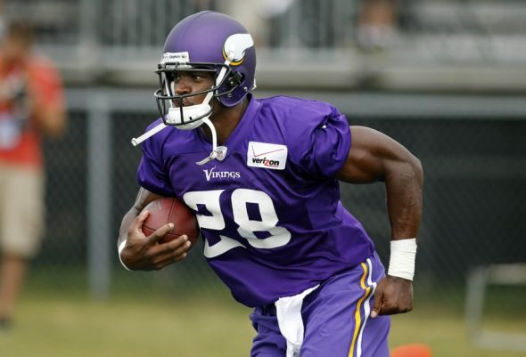 Jul 25, 2014; Mankato, MN, USA; Minnesota Vikings running back Adrian Peterson (28) runs through drills at training camp at Minnesota State University. Mandatory Credit: Bruce Kluckhohn-USA TODAY Sports