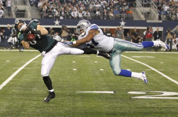 Dec 29, 2013; Arlington, TX, USA; Philadelphia Eagles tight end Brent Celek (87) catches a pass while defended by Dallas Cowboys middle linebacker DeVonte Holloman (57) in the third quarter at AT&T Stadium. The Eagle beat the Cowboys 24-22. Mandatory Credit: Tim Heitman-USA TODAY Sports