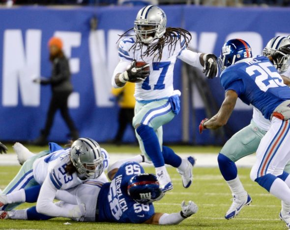 Nov 24, 2013; East Rutherford, NJ, USA; Dallas Cowboys wide receiver Dwayne Harris (17) runs past New York Giants middle linebacker Mark Herzlich (58) in the first half during the game at MetLife Stadium. Mandatory Credit: Robert Deutsch-USA TODAY Sports