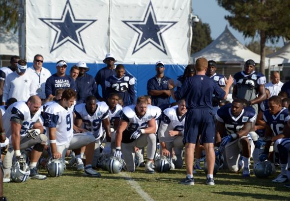 Jul 31, 2014; Oxnard, CA, USA; Dallas Cowboys coach Jason Garrett addresses players at training camp at the River Ridge Fields. Mandatory Credit: Kirby Lee-USA TODAY Sports