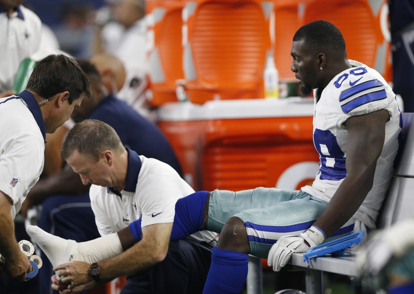 Sep 13 2015 Arlington TX USA Dallas Cowboys receiver Dez Bryant gets his right ankle worked on by trainers while on the bench in the fourth quarter against the New York Giants at AT&T Stadium. Mandatory Credit Matthew Emmons-USA TODAY Sports