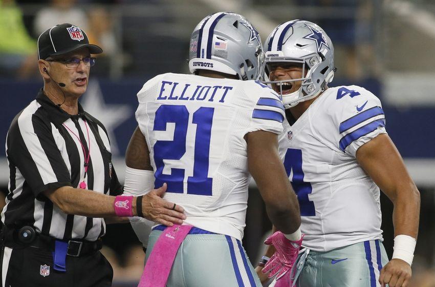 376f772a Oct 9, 2016; Arlington, TX, USA; Dallas Cowboys running back Ezekiel Elliott  (21) celebrates with quarterback Dak Prescott (4) after scoring a touchdown  in ...