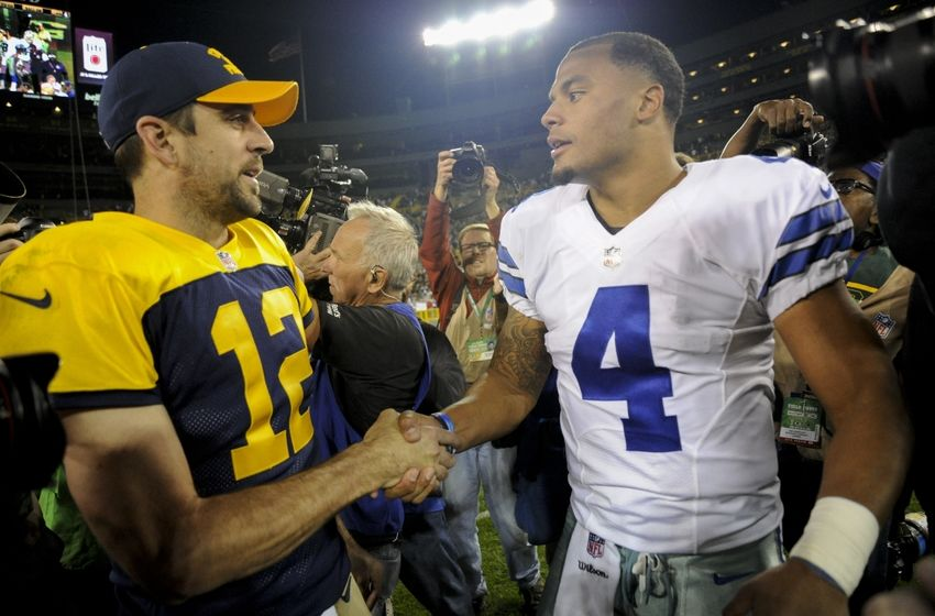 Oct 16, 2016; Green Bay, WI, USA; Green Bay Packers quarterback Aaron Rodgers (12) and Dallas Cowboys quarterback Dak Prescott (4) shake hands after thier game at Lambeau Field. Mandatory Credit: Benny Sieu-USA TODAY Sports