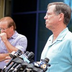 May 2, 2012; San Diego, CA, USA; San Diego Chargers head coach Norv Turner (right) addresses the media as owner Dean Spanos listens at Charger Park after the news of the death of former player Junior Seau. Mandatory Credit: Jake Roth-US PRESSWIRE