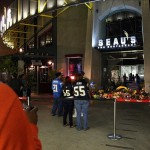 May 2, 2012; San Diego, CA, USA; San Diego fans stand near an impromptu memorial for former San Diego Charger linebacker Junior Seau at Seau