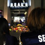 May 2, 2012; San Diego, CA, USA; San Diego Charger fans Angela Weidmann (right) and Kristina Bautista stand near an impromptu memorial for former San Diego Charger linebacker Junior Seau at Seau