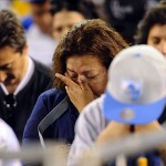 May 11, 2012; San Diego, CA, USA; San Diego Chargers fansbow their heads in prayer during a celebration of life service for former Chargers player Junior Seau at Qualcomm Stadium. Mandatory Credit: Christopher Hanewinckel-US PRESSWIRE