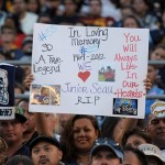 May 10, 2012; San Diego, CA, USA; A fan holds a sign in the memory of Junior Seau at the Celebration of Life for Junior Seau at Qualcomm Stadium. Mandatory Credit: Kirby Lee/Image of Sport-US PRESSWIRE