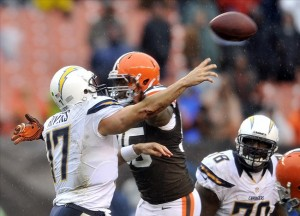 Oct 28, 2012; Cleveland, OH, USA; Cleveland Browns defensive end Juqua Parker (95) pressures San Diego Chargers quarterback Philip Rivers (17) in the fourth quarter at Cleveland Browns Stadium. Mandatory Credit: David Richard-US PRESSWIRE