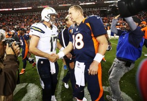 November 18, 2012; Denver, CO, USA; Denver Broncos quarterback Peyton Manning (18) and San Diego Chargers quarterback Phillip Rivers (17) after the game at Sports Authority Field at Mile High. The Broncos won 30-23. Mandatory Credit: Chris Humphreys-USA TODAY Sports