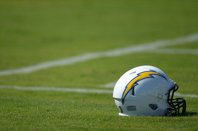 July 26, 2012; San Diego, CA, USA; A detailed view of a San Diego Chargers helmet on the grass during training camp at Charger Park. Mandatory Credit: Jake Roth-USA TODAY Sports