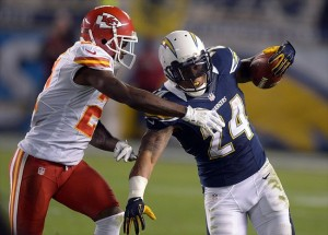 Nov 1, 2012; San Diego CA, USA; San Diego Chargers running back Ryan Matthews (24) is defended by Kansas City Chiefs cornerback Javier Arenas (21) on a 31- yard run at Qualcomm Stadium. The Chargers defeated the Chiefs 31-6. Mandatory Credit: Kirby Lee/Image of Sport-USA TODAY Sports