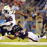 Sep 9, 2013; San Diego, CA, USA; San Diego Chargers tight end Antonio Gates (85) runs past a tackle attempt by Houston Texans safety D.J. Swearinger (36) during the first half at Qualcomm Stadium. Mandatory Credit: Christopher Hanewinckel-USA TODAY Sports