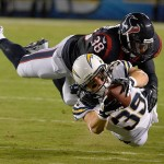 Sep 9, 2013; San Diego, CA, USA; San Diego Chargers running back Danny Woodhead (39) dives to try to stretch for a first down as he is tackled by Houston Texans free safety Danieal Manning (38) during first half action at Qualcomm Stadium. Woodhead was a yard short. Mandatory Credit: Robert Hanashiro-USA TODAY