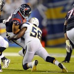 Sep 9, 2013; San Diego, CA, USA; Houston Texans running back Arian Foster (23) is stopped by San Diego Chargers linebacker Donald Butler (56) short of the first down during the first half at Qualcomm Stadium. Mandatory Credit: Christopher Hanewinckel-USA TODAY Sports