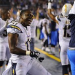 Sep 9, 2013; San Diego, CA, USA; San Diego Chargers receiver Eddie Royal (11) celebrates on the sidelines after a touchdown during the first half against the Houston Texans at Qualcomm Stadium. Mandatory Credit: Christopher Hanewinckel-USA TODAY Sports