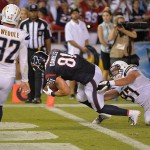 Sep 9, 2013; San Diego, CA, USA; Houston Texans tight end Owen Daniels (81) slips past San Diego Chargers linebacker Bront Bird (97) to score a second half touchdown at Qualcomm Stadium. Mandatory Credit: Robert Hanashiro-USA TODAY
