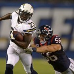 Sep 9, 2013; San Diego, CA, USA; San Diego Chargers running back Ronnie Brown (23) is tackled by Houston Texans linebacker Brian Cushing (56) at Qualcomm Stadium. The Texans defeated the Chargers 31-28. Mandatory Credit: Kirby Lee-USA TODAY Sports