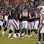 Sep 9, 2013; San Diego, CA, USA; Houston Texans kicker Randy Bullock (4) celebrates with teammates after his game-winning field goal to defeat the Chargers 31-28 at Qualcomm Stadium. At right is San Diego Chargers cornerback Derek Cox (22). Mandatory Credit: Robert Hanashiro-USA TODAY