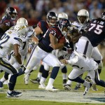 Sep 9, 2013; San Diego, CA, USA; Houston Texans running back Arian Foster (23) is defended by San Diego Chargers cornerback Derek Cox (22) and safety Eric Weddle (32) at Qualcomm Stadium. The Texans defeated the Chargers 31-28. Mandatory Credit: Kirby Lee-USA TODAY Sports