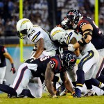 Sep 9, 2013; San Diego, CA, USA; Houston Texans defensive end J.J. Watt (99) tackles San Diego Chargers running back Ryan Mathews (24) after a short gain during the second half at Qualcomm Stadium. Mandatory Credit: Christopher Hanewinckel-USA TODAY Sports