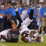 Sep 9, 2013; San Diego, CA, USA; San Diego Chargers wide receiver Eddie Royal (11) is upended by Houston Texans defensive back Shiloh Keo (31) during first half action at Qualcomm Stadium. Mandatory Credit: Robert Hanashiro-USA TODAY