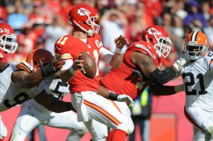 Oct 27, 2013; Kansas City, MO, USA; Kansas City Chiefs quarterback Alex Smith (11) is hit by Cleveland Browns defensive end Desmond Bryant (92) during the second half at Arrowhead Stadium. The Chiefs won 23-17. Mandatory Credit: Denny Medley-USA TODAY Sports