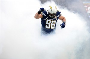 Dec 16, 2012; San Diego, CA, USA; San Diego Chargers outside linebacker Jarret Johnson (96) runs out of the smoke during pregame introduction before a game against the Carolina Panthers at Qualcomm Stadium. Mandatory Credit: Jake Roth-USA TODAY Sports