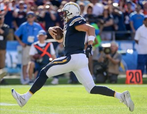 Nov 10, 2013; San Diego, CA, USA; San Diego Chargers quarterback Philip Rivers (17) sprints for a first down during the first half against the Denver Broncos at Qualcomm Stadium. Mandatory Credit: Robert Hanashiro-USA TODAY Sports