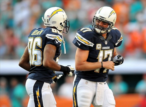 Nov 17, 2013; Miami Gardens, FL, USA; San Diego Chargers quarterback Philip Rivers (17) talks with San Diego Chargers wide receiver Vincent Brown (86) after throwing an interception during the first quarter against the Miami Dolphins at Sun Life Stadium. Mandatory Credit: Steve Mitchell-USA TODAY Sports